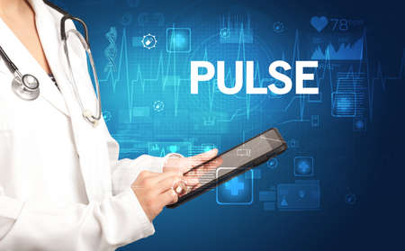 young doctor writing down notes with PULSE  inscription, healthcare concept