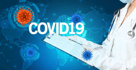 Doctor fills out medical record with COVID19  inscription, virology concept