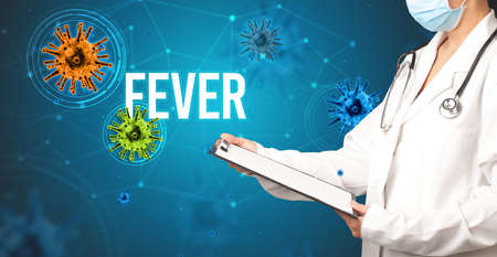doctor prescribes a prescription with FEVER  inscription, pandemic concept Zdjęcie Seryjne