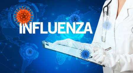 Doctor fills out medical record with INFLUENZA  inscription, virology concept