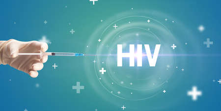 Syringe needle with virus vaccine and HIV  abbreviation, antidote concept Stock Photo