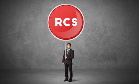 Young business person holdig traffic sign with RCS abbreviation, technology solution concept