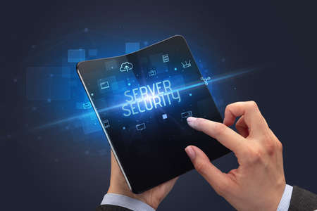 Businessman holding a foldable smartphone with SERVER SECURITY inscription, cyber security concept