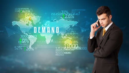 Businessman in front of a decision with DEMAND inscription, business concept