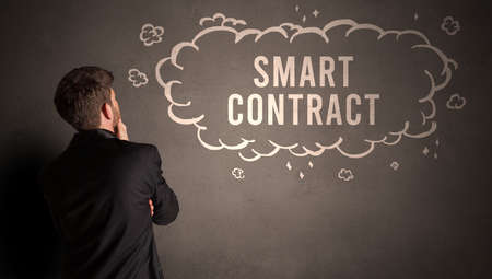 businessman drawing a cloud with SMART CONTRACT inscription inside, modern business concept