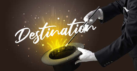 Magician is showing magic trick with Destination inscription, traveling concept