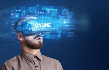 Businessman looking through Virtual Reality glasses with ONLINE inscription, innovative security concept Standard-Bild