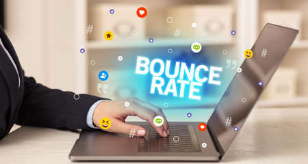 Freelance woman using laptop with BOUNCE RATE inscription, Social media concept