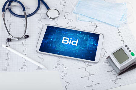 Close-up view of a tablet pc with Bid abbreviation, medical concept