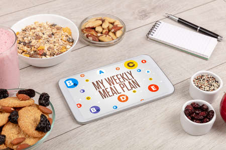 Healthy Tablet Pc compostion with MY WEEKLY MEAL PLAN inscription, weight loss concept