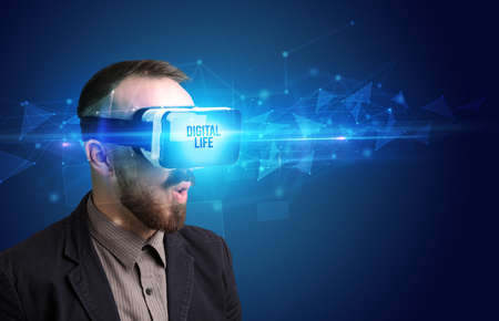 Businessman looking through Virtual Reality glasses with DIGITAL LIFE inscription, cyber security concept Standard-Bild