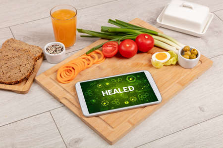 Healthy Tablet Pc compostion with HEALED inscription, immune system boost concept Stock fotó