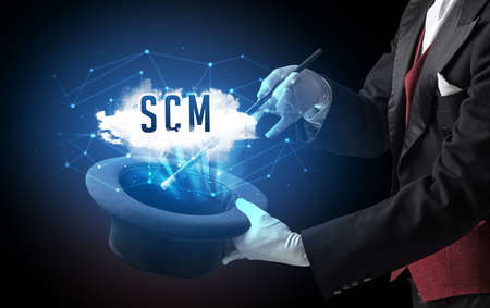 Magician is showing magic trick with SCM abbreviation, modern tech concept