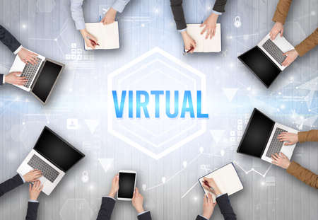 Group of Busy People Working in an Office with VIRTUAL inscription, modern technology concept