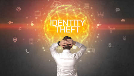Rear view of a businessman with IDENTITY THEFT inscription, online security concept
