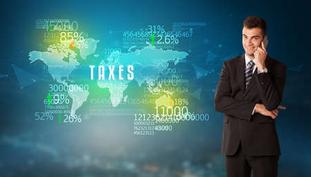 Businessman in front of a decision with TAXES inscription, business concept