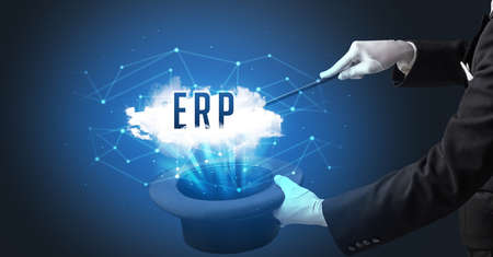 Magician is showing magic trick with ERP abbreviation, modern tech concept