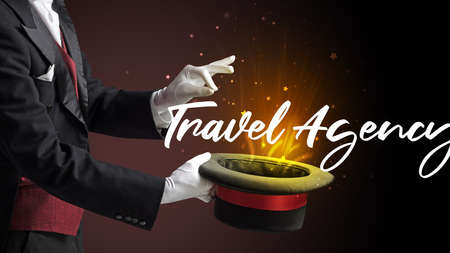 Magician is showing magic trick with Travel Agency inscription, traveling concept