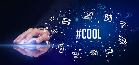 hand holding wireless peripheral with #COOL inscription, social media concept