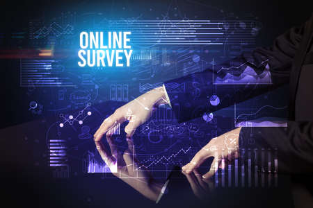 Businessman touching huge screen with ONLINE SURVEY inscription, cyber business concept