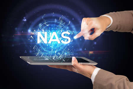 Close-up of a touchscreen with NAS abbreviation, modern technology concept Banco de Imagens