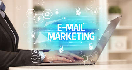 E-MAIL MARKETING inscription on laptop, internet security and data protection concept, blockchain and cybersecurity