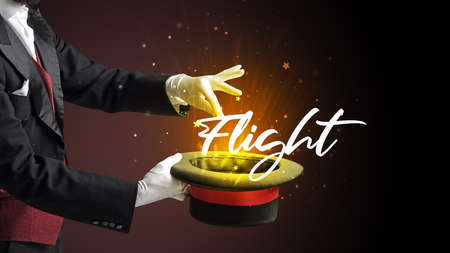 Magician is showing magic trick with Flight inscription, traveling concept