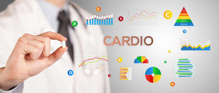 Nutritionist giving you a pill with CARDIO inscription, healthy lifestyle concept
