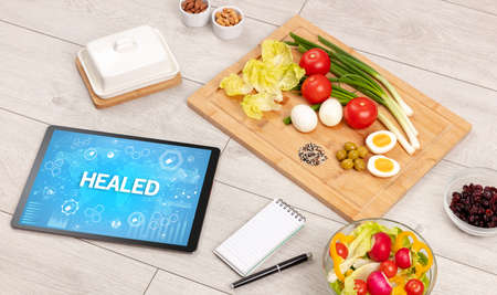 Healthy Tablet Pc compostion with HEALED inscription, immune system boost concept
