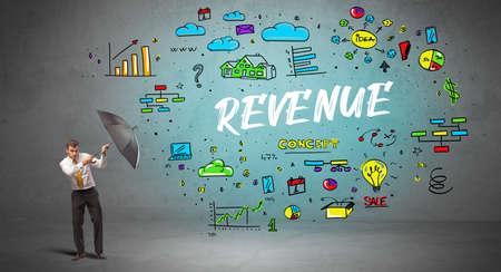 Determined businessman hiding behind umbrella with REVENUE inscription, new business concept