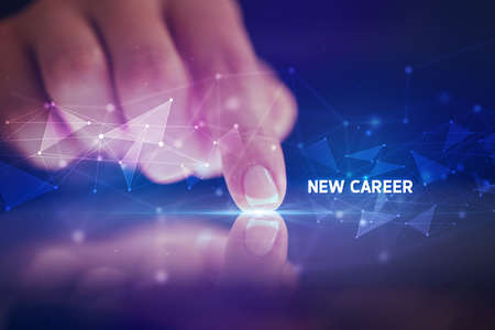 Finger touching tablet with NEW CAREER inscription, business concept