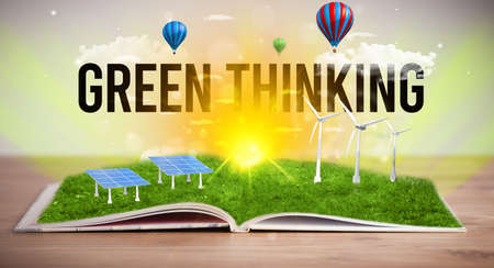 Open book with GREEN THINKING inscription, renewable energy concept