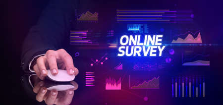 hand holding wireless peripheral with ONLINE SURVEY inscription, cyber business concept Zdjęcie Seryjne
