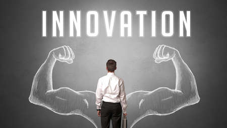 Rear view of a businessman with INNOVATION inscription, powerfull business concept
