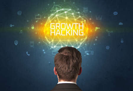 Rear view of a businessman with GROWTH HACKING inscription, online security concept