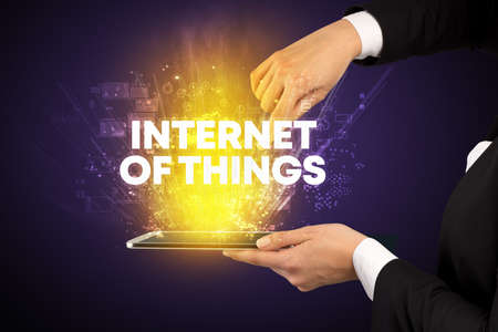 Close-up of a touchscreen with INTERNET OF THINGS inscription, innovative technology concept