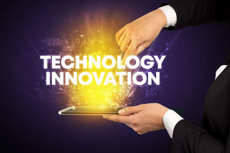 Close-up of a touchscreen with TECHNOLOGY INNOVATION inscription, innovative technology concept