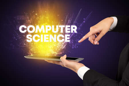 Close-up of a touchscreen with COMPUTER SCIENCE inscription, innovative technology concept Banco de Imagens