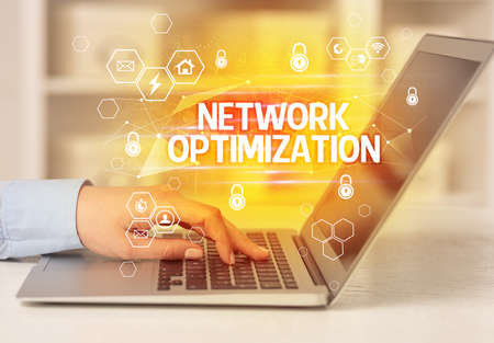 NETWORK OPTIMIZATION inscription on laptop, internet security and data protection concept, blockchain and cybersecurity