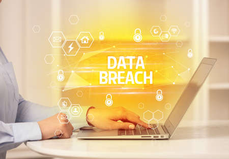 DATA BREACH inscription on laptop, internet security and data protection concept, blockchain and cybersecurity