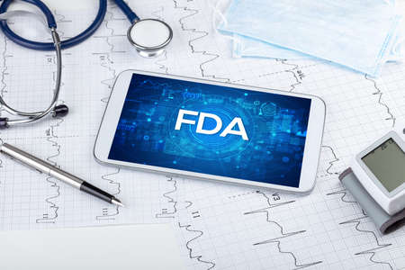 Close-up view of a tablet pc with FDA abbreviation, medical concept