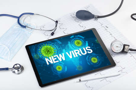 Close-up view of a tablet pc with NEW VIRUS inscription, microbiology concept Stock Photo