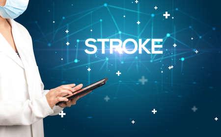 Doctor fills out medical record with STROKE inscription, medical concept Reklamní fotografie