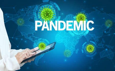 Doctor fills out medical record with PANDEMIC inscription, virology concept Reklamní fotografie