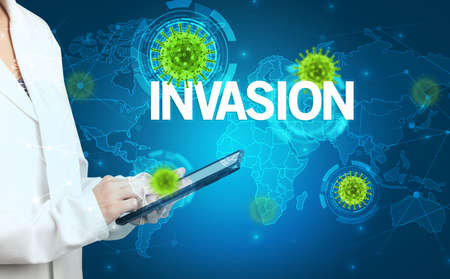 Doctor fills out medical record with INVASION inscription, virology concept