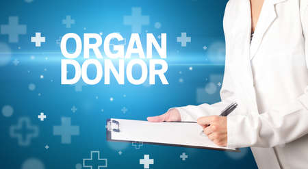 doctor writes notes on the clipboard with ORGAN DONOR inscription, first aid concept