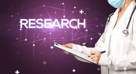 Doctor fills out medical record with RESEARCH inscription, medical concept