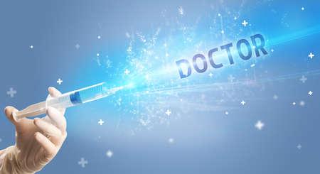 Syringe, medical injection in hand with DOCTOR inscription, medical antidote concept Reklamní fotografie