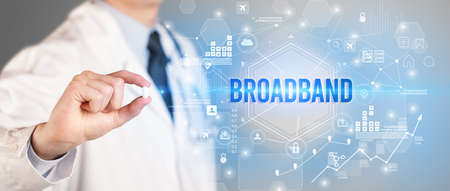 Doctor giving a pill with BROADBAND inscription, new technology solution concept
