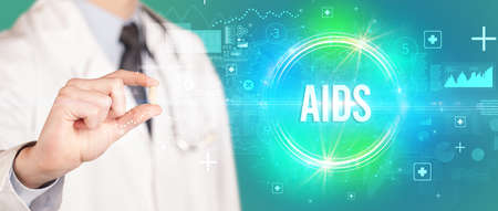 Close-up of a doctor giving you a pill with AIDS abbreviation, virology concept